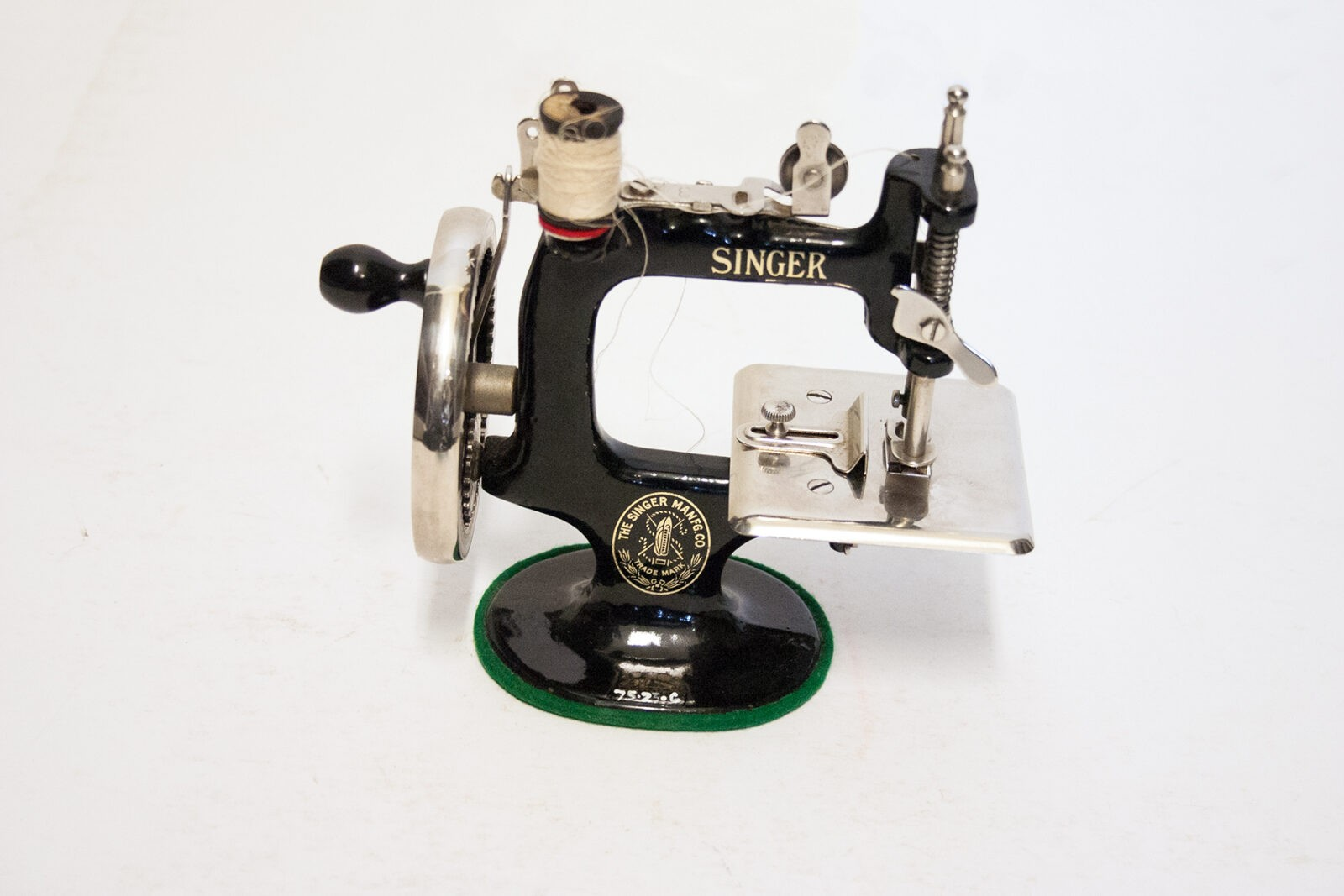 A black and nickel sewing machine, photographed on a white background.