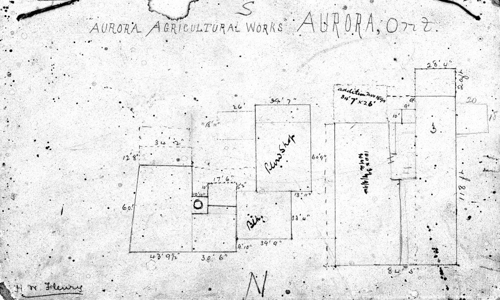 A speckled and stained hand-drawn overhead plan of a 19th century factory complex with measurements and cardinal directions, signed in the corner.