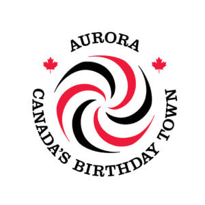 A circular logo in pinwheel shape of red, black and white. Text around reads Aurora Canada's Birthday Town