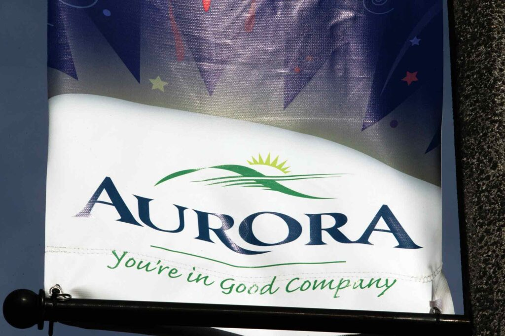 A photograph of streetlight-mounted banner advertising the Town of Aurora.