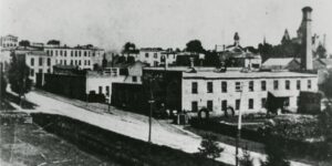 Black and white postcard image of factory buildings.