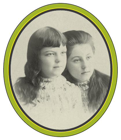 A black and white photograph of two young girls, the older leaning into the younger.
