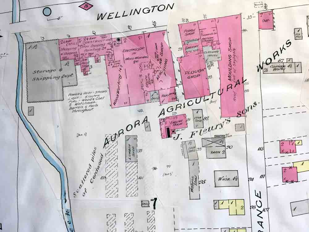 A portion of a hand-drawn map detailing the buildings making up a large agricultural implement factory.