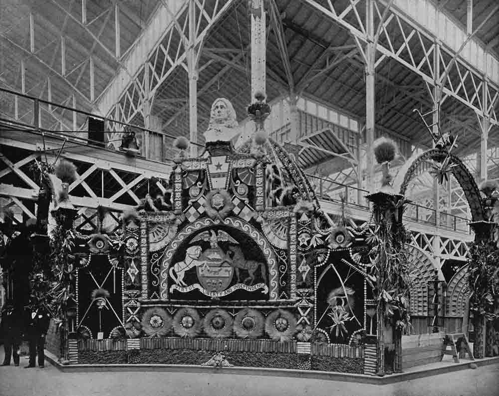A black and white photogrpah of an ornate exhibition pavilion.