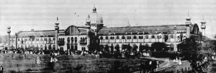 A wide black and white photograph of an ornate building with a domed rotunda.