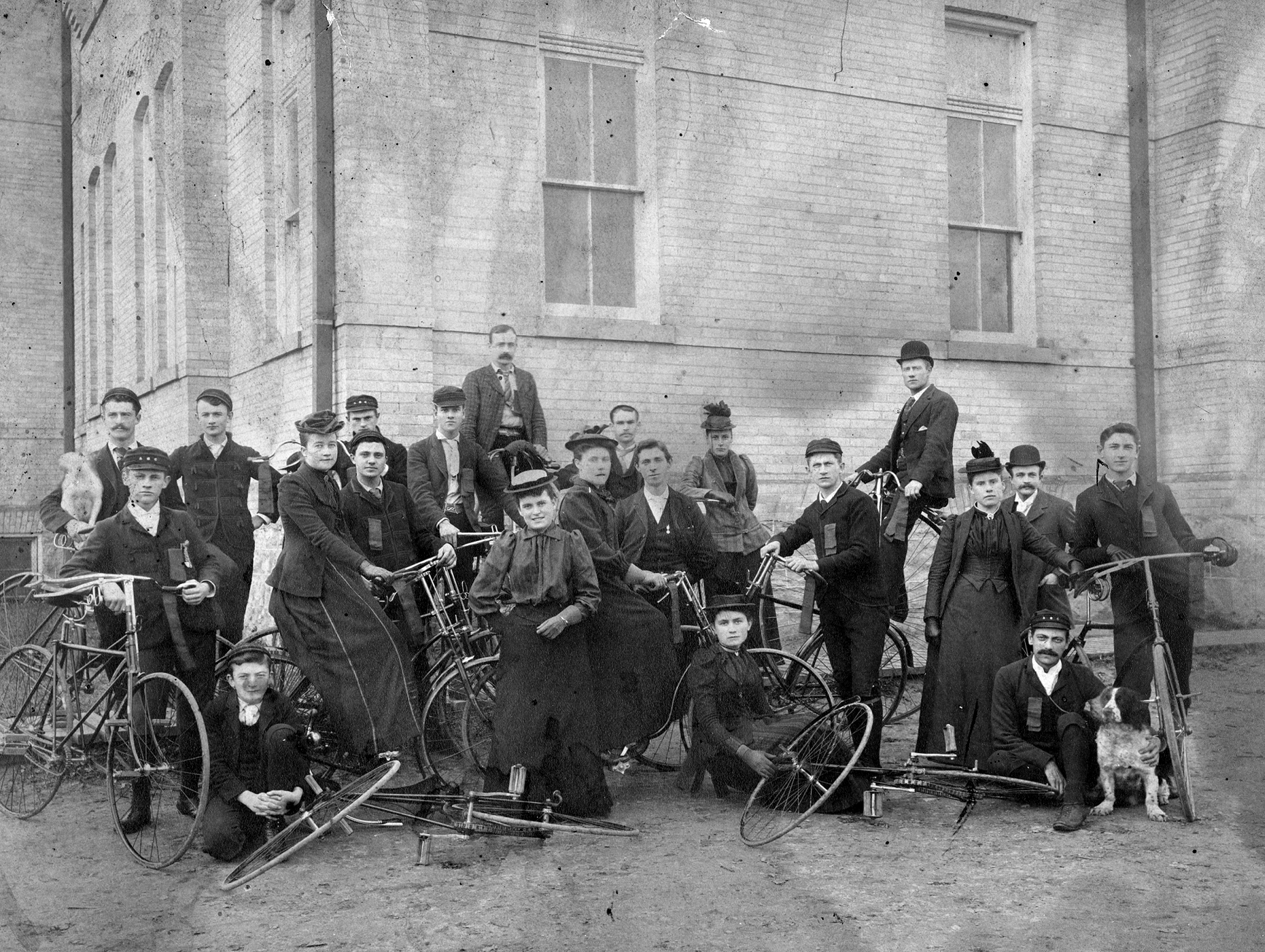 A black and white photograph of a group of cyclists.