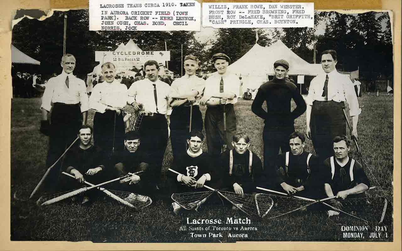 A black and white team photo of a lacrosse team with text glued to the photo.